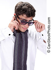 Portrait of a handsome young man in glasses posing on white background
