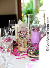 Delicate floral table centrepiece with individual small...