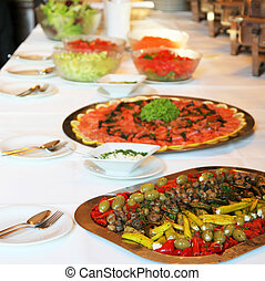 array of dishes placed on buffet table