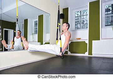 TRX - Fitness traine in a gym.