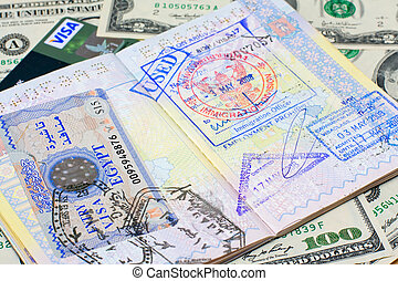 Passport and money - Passport with stamps with us dollar,...