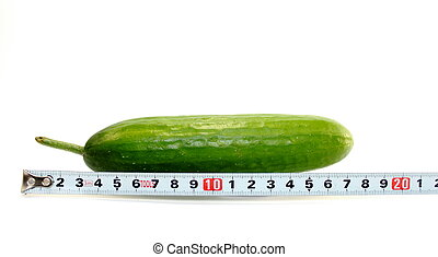 Large cucumber and a measuring tape on white background