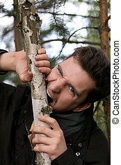 Man who gnaw their teeth wood