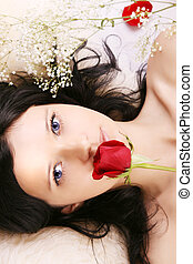Beautiful brunette girl with a rose