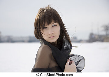 Girl against a background of snow and the city. - Picture of...