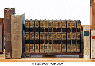 Book shelf - Old grunge books in leather binding on wooden...