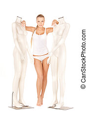 woman in cotton underwear with mannequins - beautiful woman...