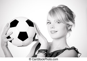 Blond girl in a blue dress with soccer ball - Image of the...