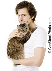 Man who keeps on hand fluffy cat - Picture of a young man...