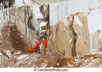 Marble quarry with  excavator in Carrara, Tuscany, Italy