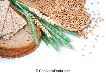 tasty baked bread with ears and wheat grain, isolated on a white background