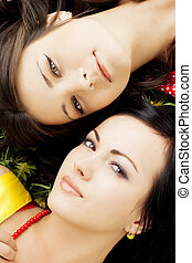 Two beautiful girls lying on the grass. - Picture of two...
