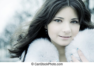 Girl in winter city - The image of a beautiful girl in the...