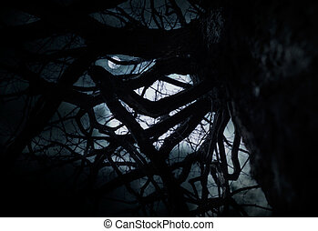 Scary dark scenery with old oak tree, full moon and clouds