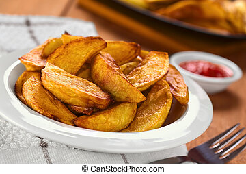 Fried Potato Wedges - Fresh homemade crispy fried potato...