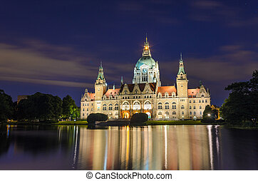 City Hall of Hannover, Germany by night with cloudy sky and...