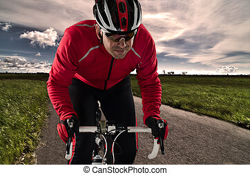 Cyclist on the road - Cyclist on road bike through a asphalt...
