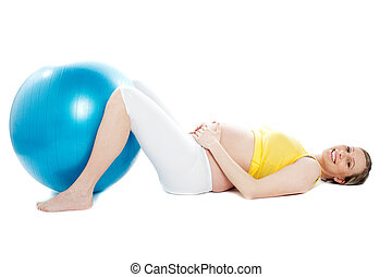 Beautiful pregnant woman lying with exercise ball. Isolated...