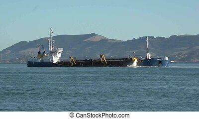 Sand dredging in Otago Harbour - Otago Harbour, New Zealand,...