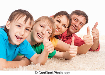 family on carpet - cute family of a four on white