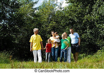 family of a seven - portrait of a cute family at nature