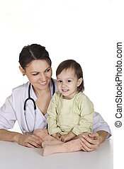 doctor with little girl - cute doctor with little girl on...
