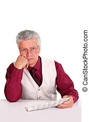old man with newspaper - old guy with newspaper at table on...