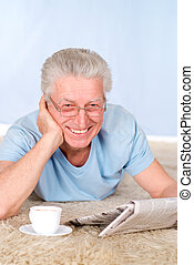 old man with newspaper - cute old man with paper and cup