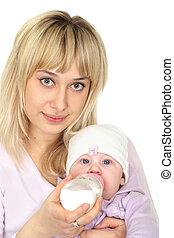 mom feeding baby - cute mom feeding baby on a white