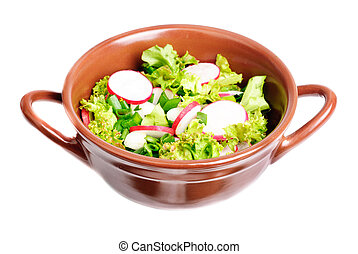 fresh salad with radishes, lettuce and onions on  bowl isolated on white