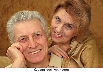 Beautiful Caucasian luck couple of aged people sitting