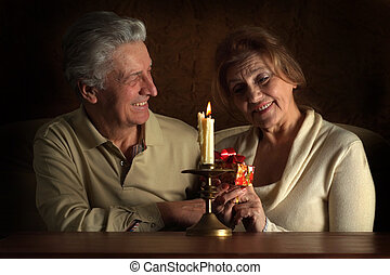 Beautiful Caucasian joy couple of old people sitting