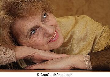 elderly woman sitting on a sofa