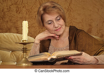 good woman sitting on a sofa on a brown background