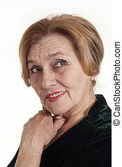 an elderly lady in a dress standing