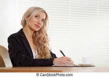 Business woman sitting at a desk