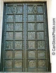 decorative metal door - a decorative metal door on a church