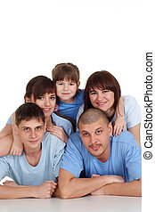 Caucasian beautiful household consisting of five persons are together on the floor on a white background