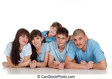 Caucasian beautiful happy family consisting of five persons are together on the floor on a white background