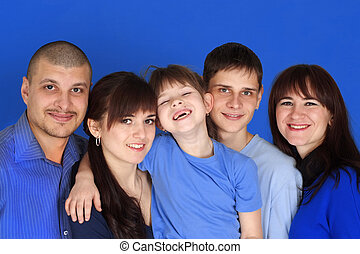 Caucasian family consisting of five people together