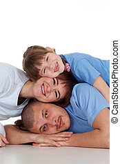 Caucasian beautiful family consisting of three people fool around on a white background
