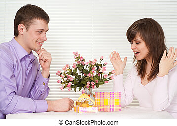 Bliss Caucasian guy and his girlfriend are sitting at a table