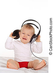 a young child listening to music through