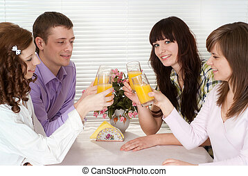 Happy Caucasian group of people with the juice of four sitting