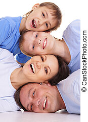 family portrait on white - cute family of a four in blue...