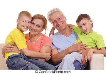 grandchildren with grandparents - Family sitting on a white...