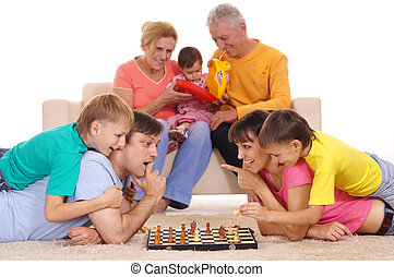family and chess - portrait of a big family playing chess