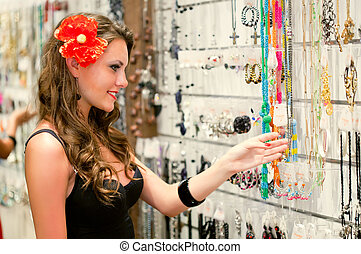 woman is choosing jewerly - Young woman is choosing jewerly...