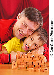 father playing with son - portrait of a father playing with...
