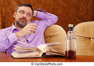 cute man with whiskey reading